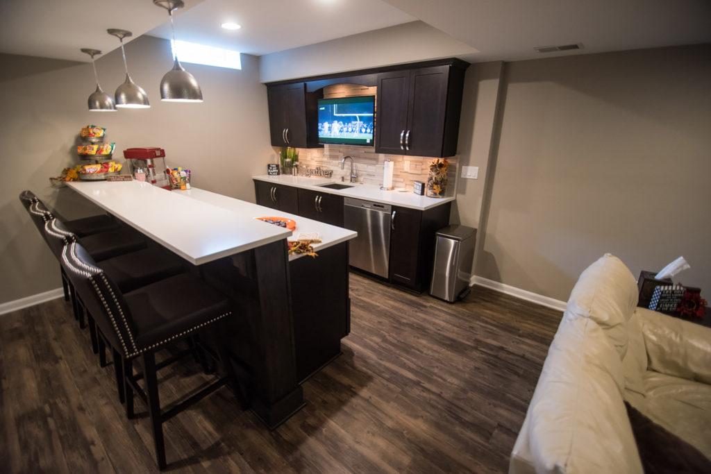 basement bar with quartz countertop