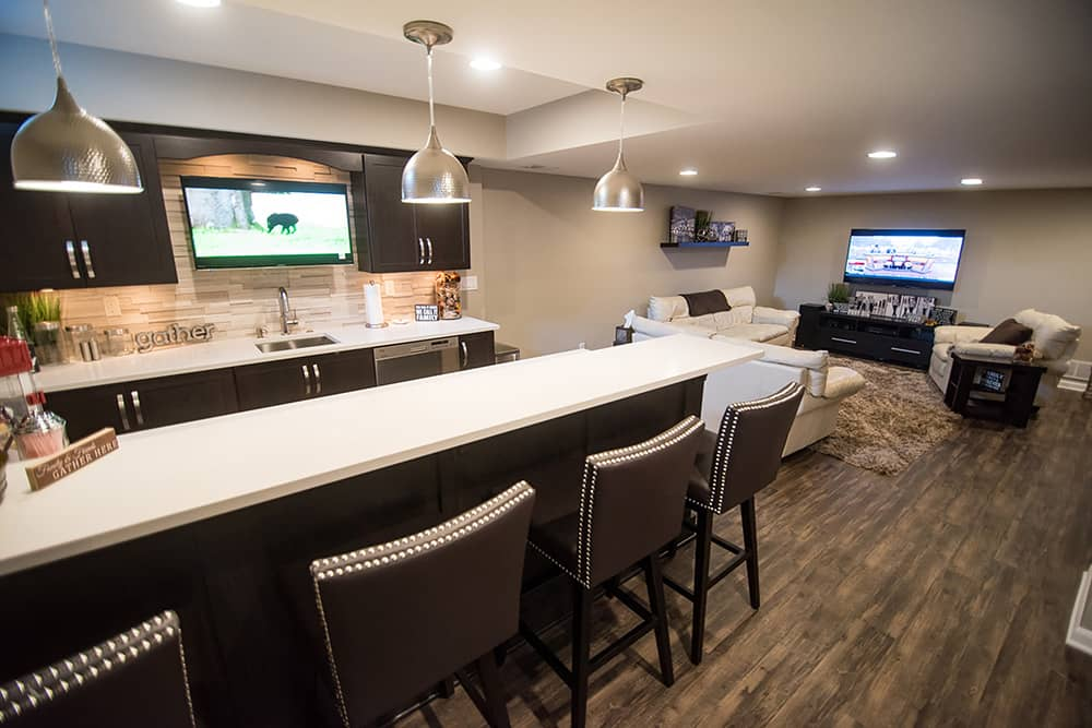 basement bar connecting to living room for open concept feel