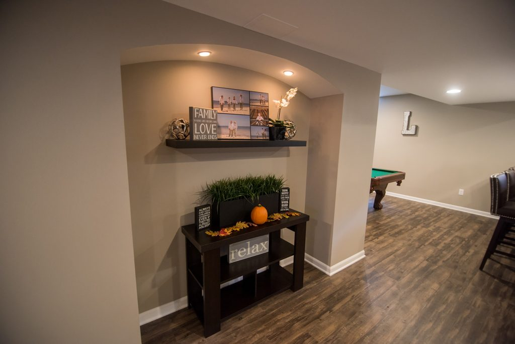 arched cutout in basement wall for added design features
