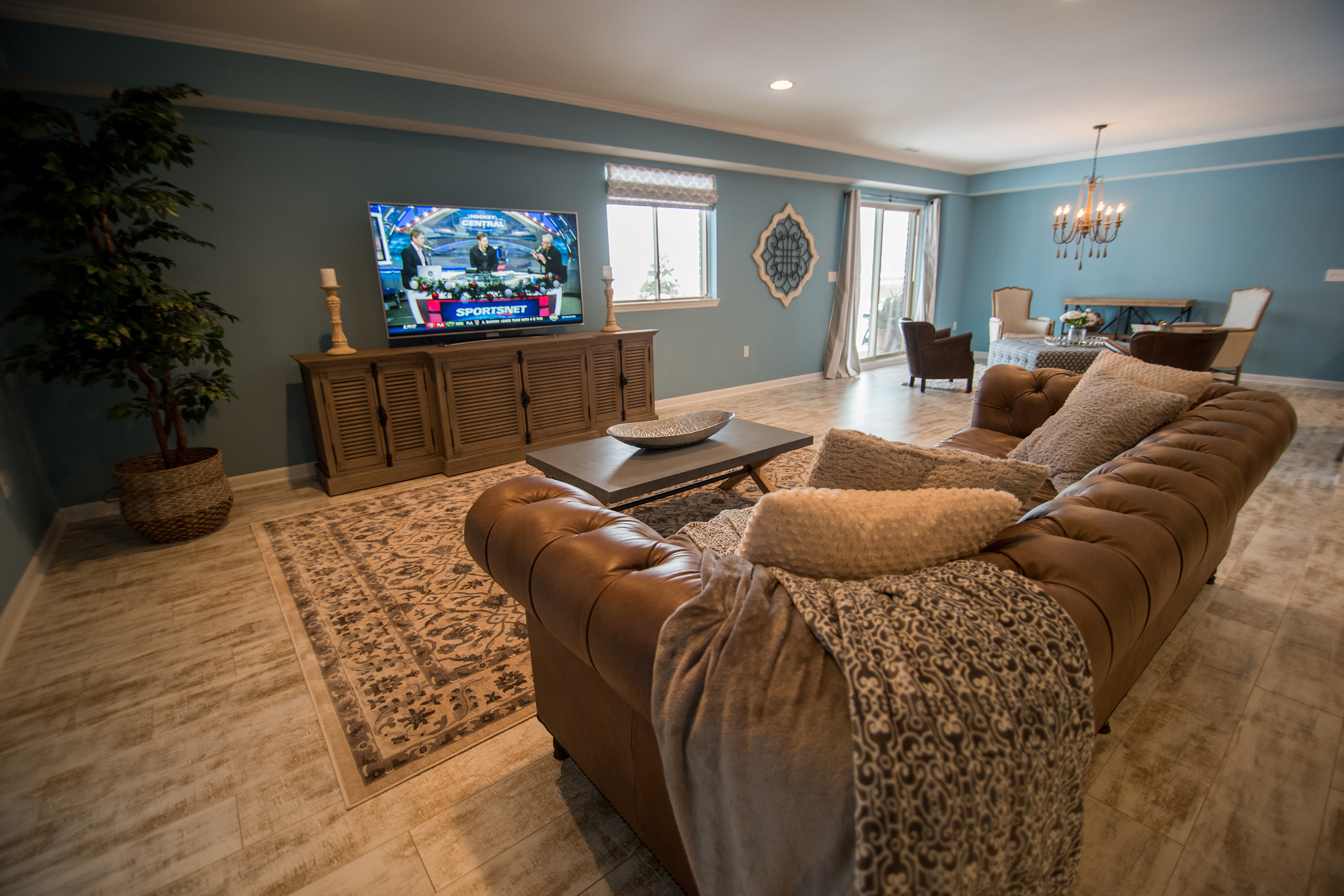 South Lyon Michigan open concept basement living room with rustic beach theme