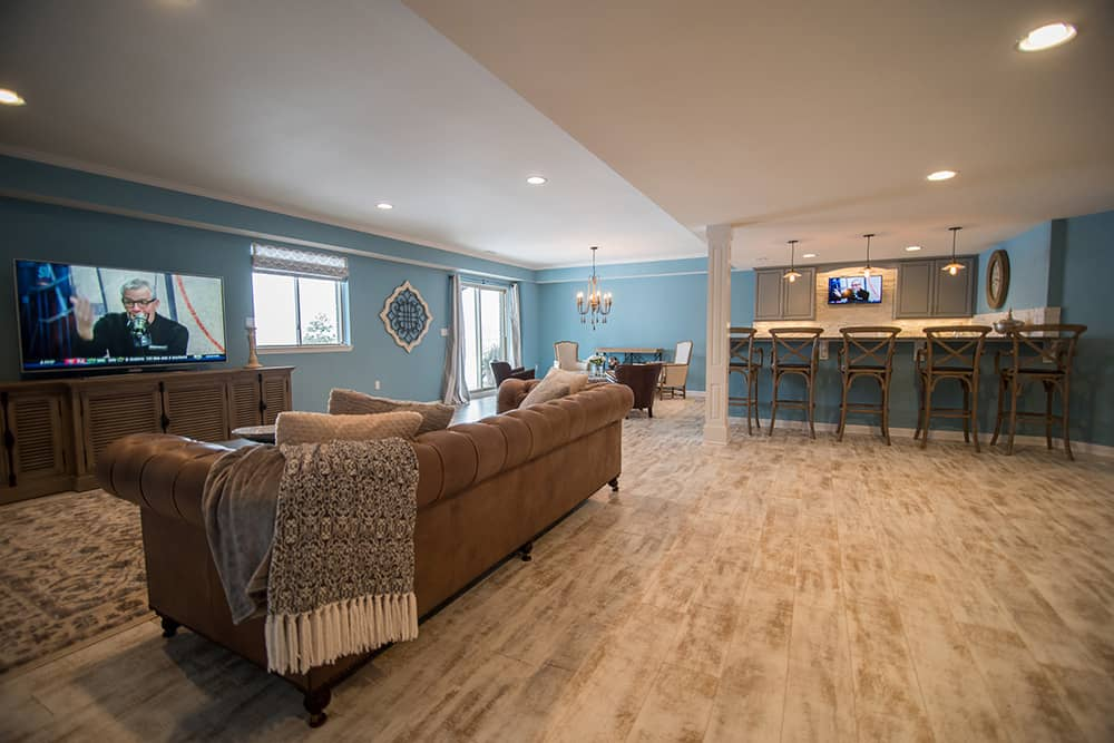 basement living room with sofa and vinyl plank flooring