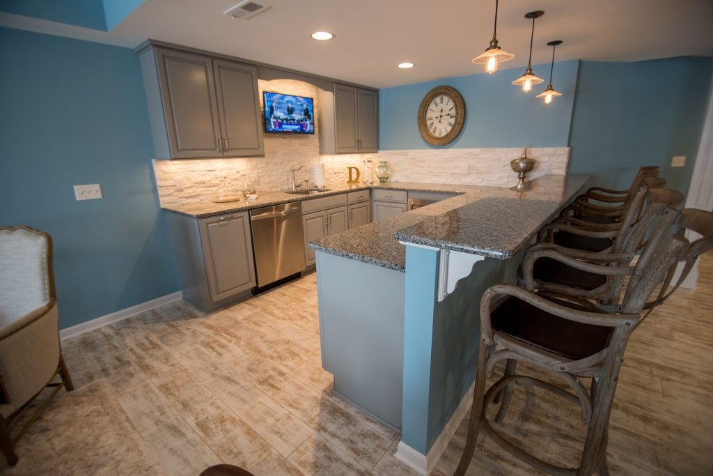 basement bar with granite countertops and extra seating
