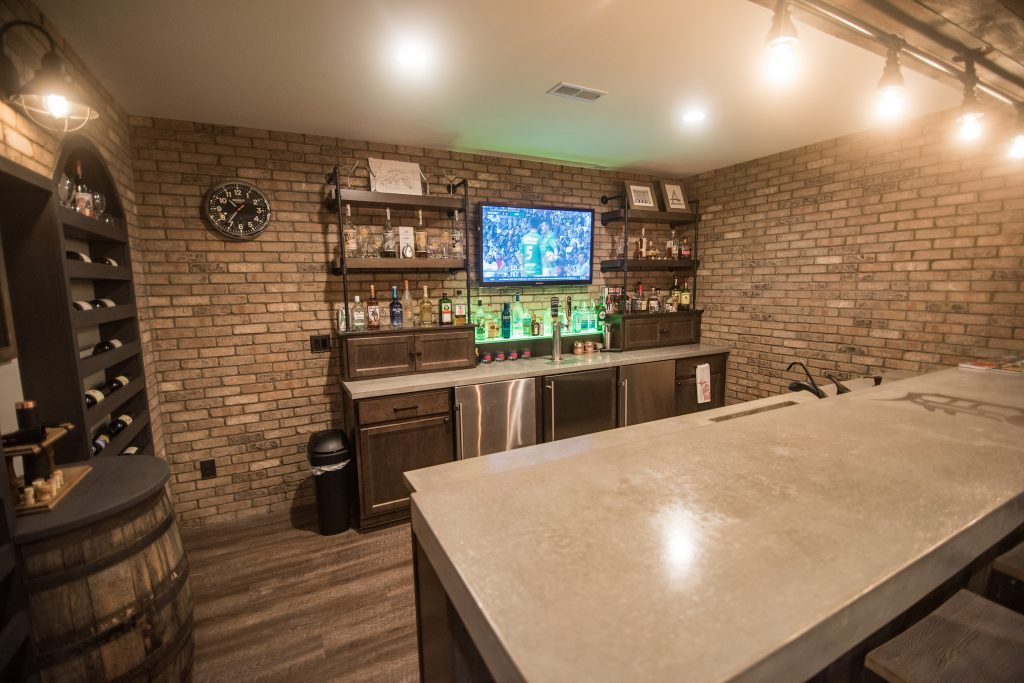 Brick walled bar with concrete countertops