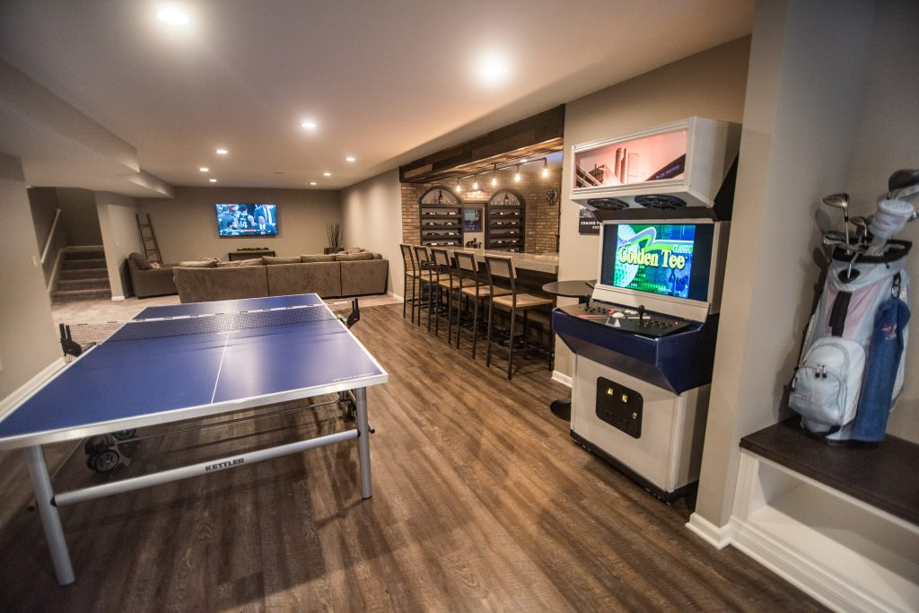 finished basement with arcade game and ping pong