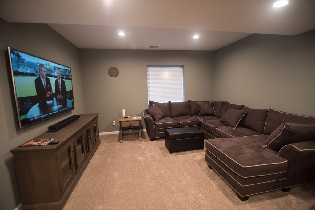 spacious basement living room with big screen tv