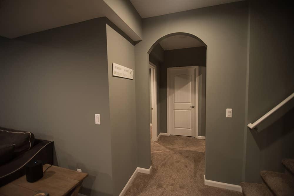 Archway design feature in basement hallway in Royal Oak, Michigan
