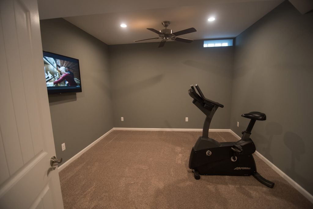 bonus room in basement being used as a fitness space