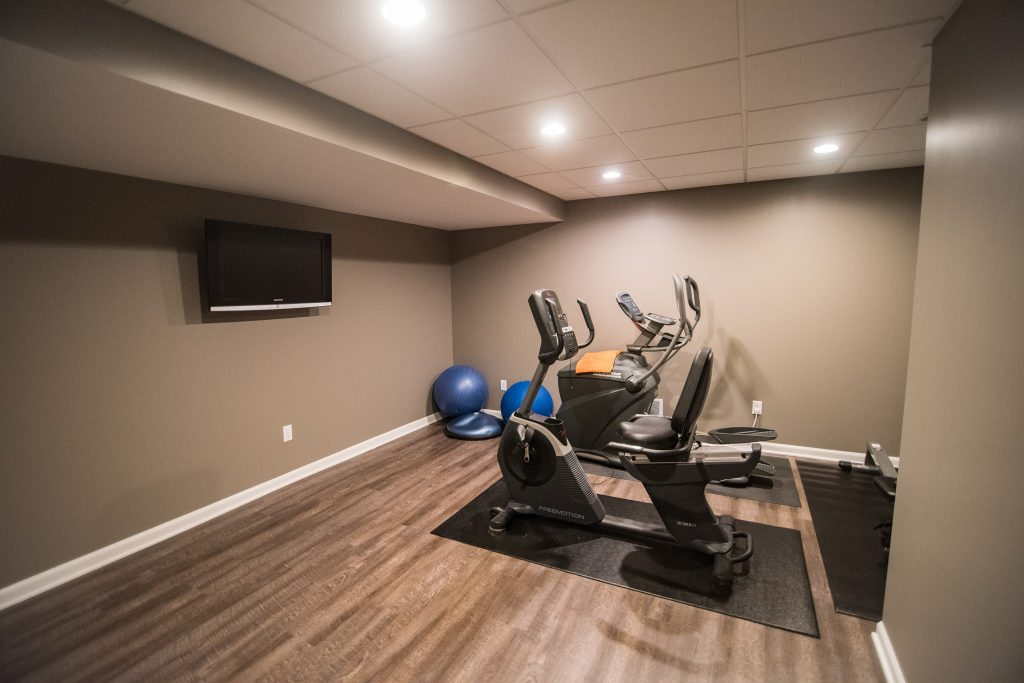 basement fitness room ad vinyl plank flooring