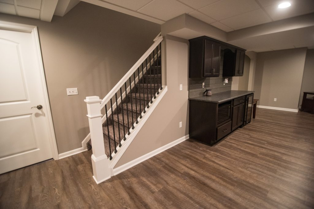 detailed staircase spindles with white railing in basement