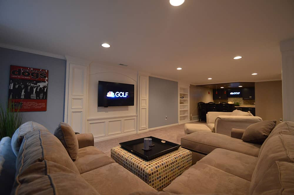 Troy Michigan living room in basement with detailed media center design