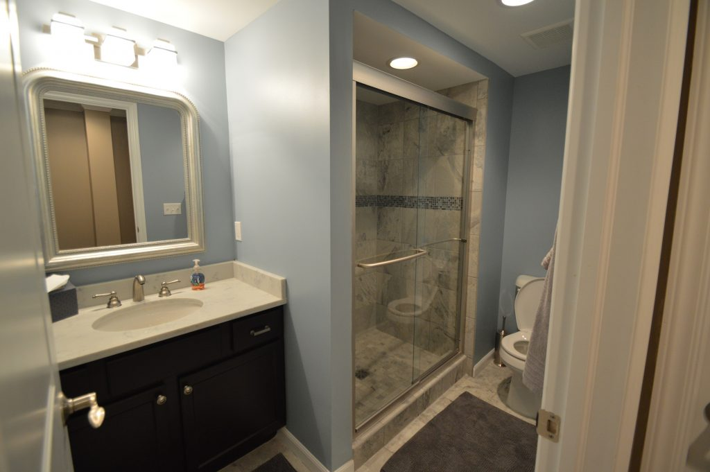 bright finished bathroom with vinyl tile