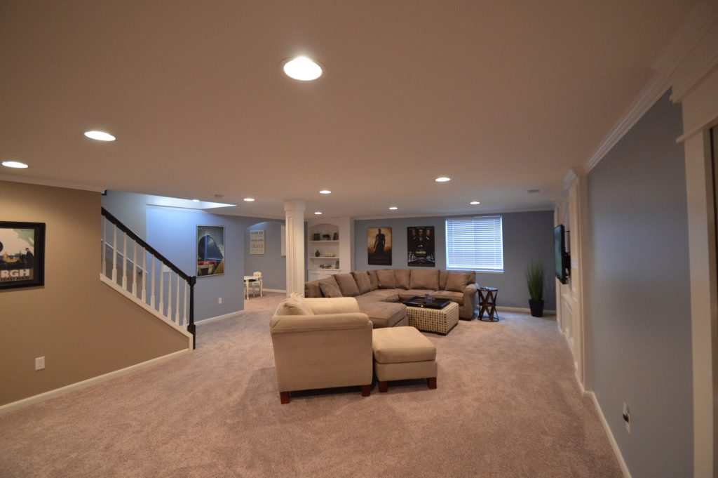 clean basement design for the whole family in troy