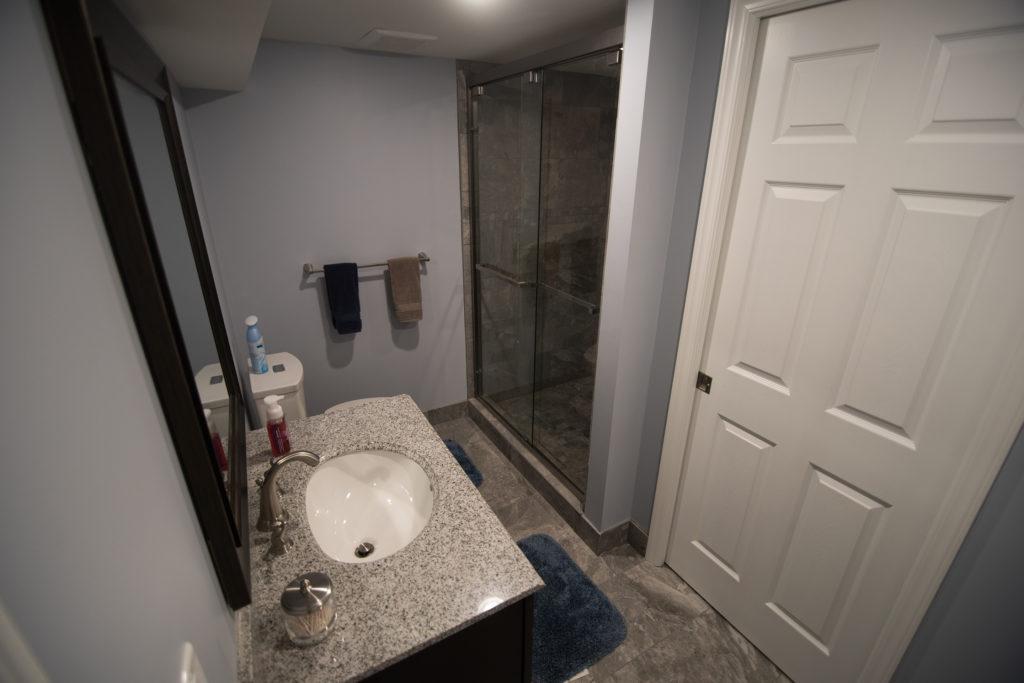 vinyl tile bathroom in basement