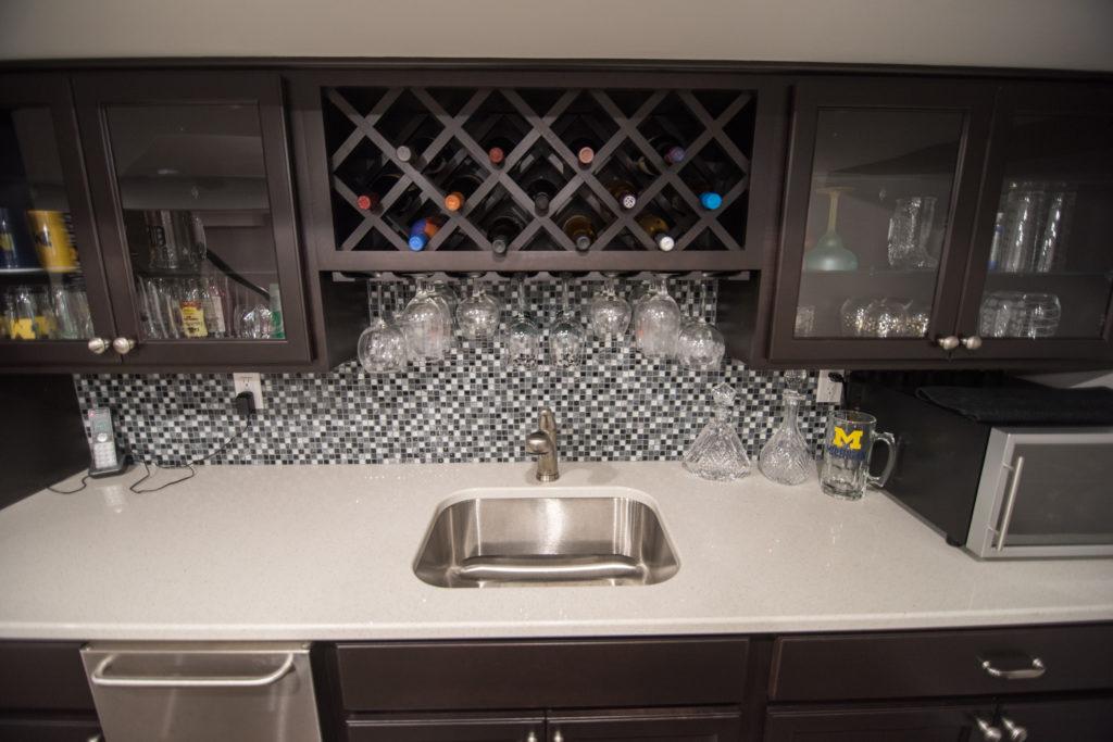 wine storage above sink in basement bar