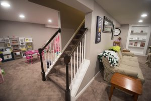 remodeled basement with grey walls and traditional design