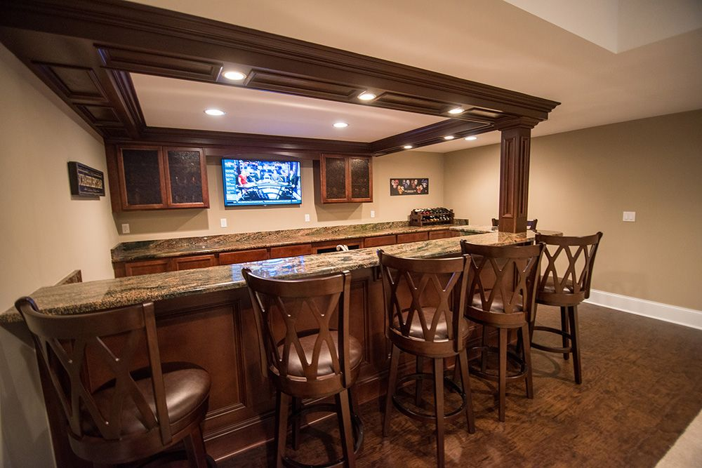 basement bar with posts and soffet work