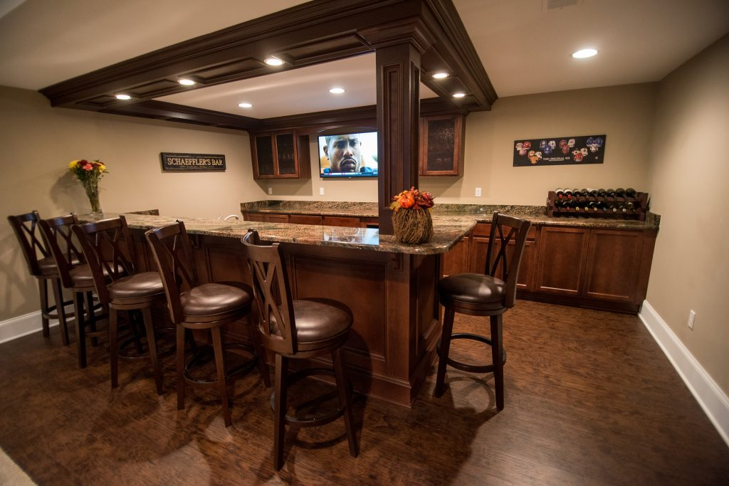 basement with detailed wood working on bar posts and ceiling