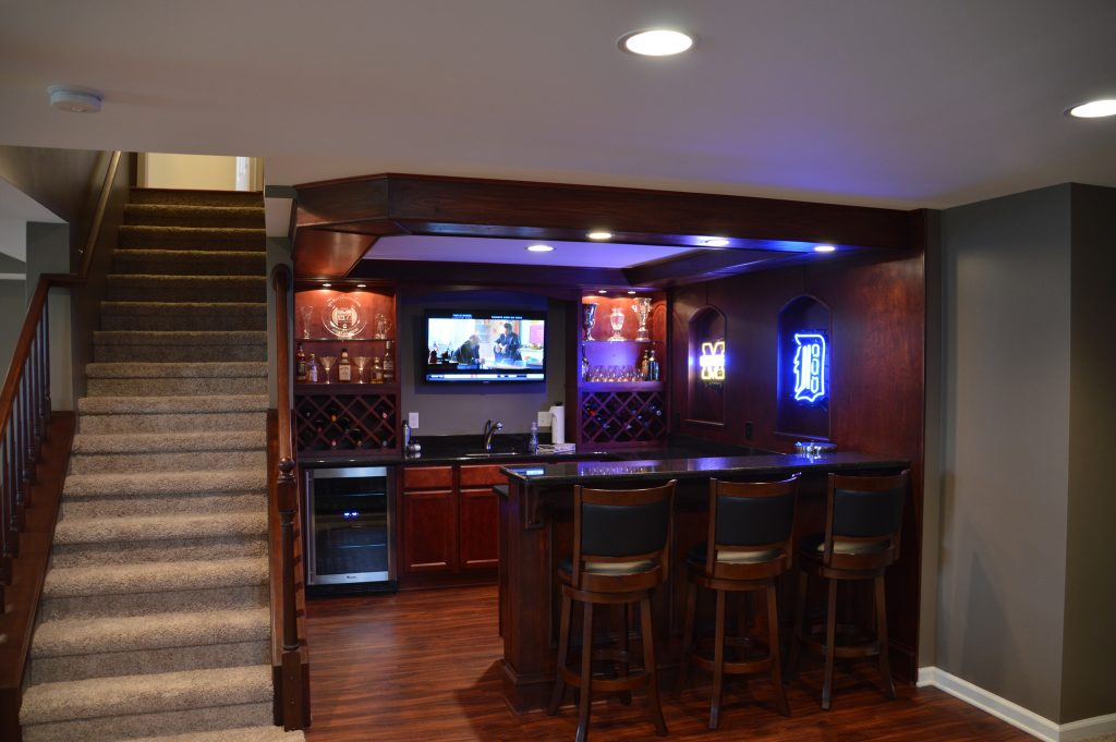 finished basement with bar area and led lighting with bar accents