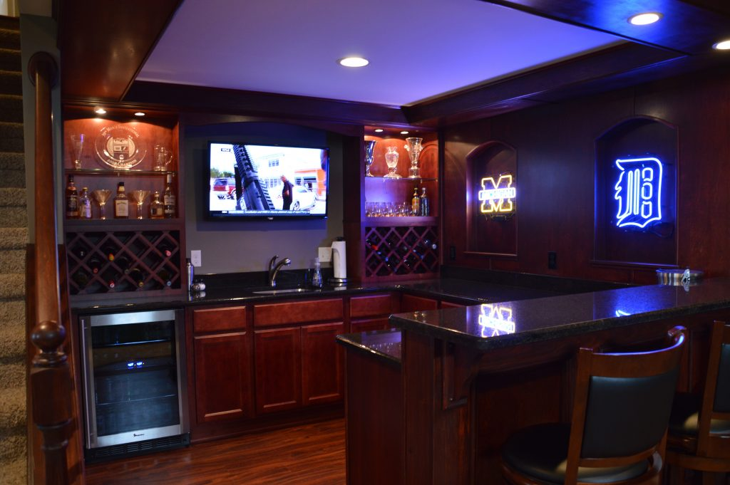 basement sports bar with detroit themed lights and tv