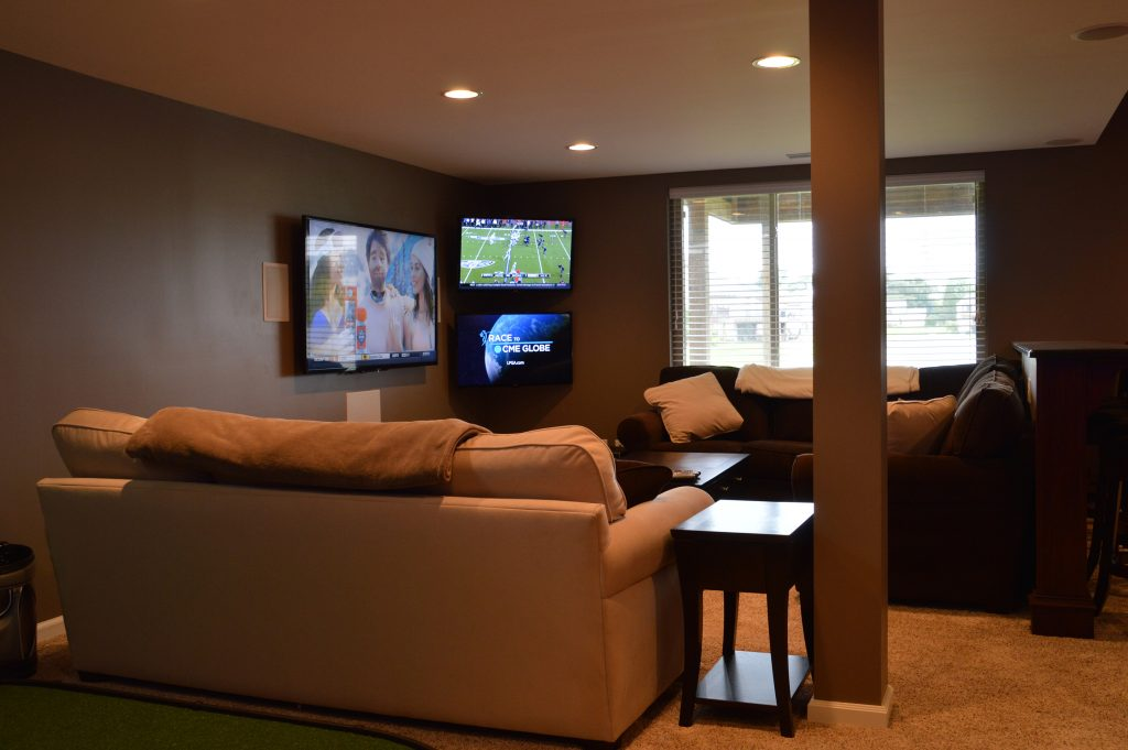 multiple tvs in living room basement