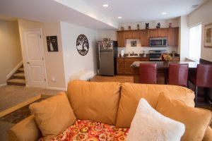 cozy family room in finished basement with large kitchen area and living room
