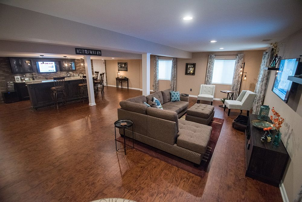 open concept basement with bar and living room