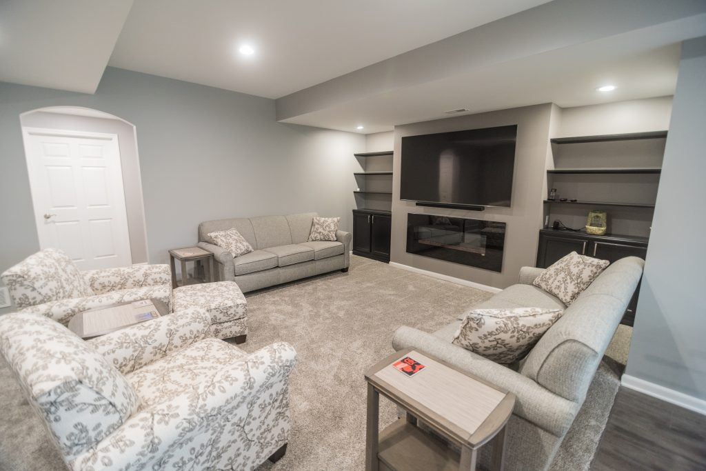 brighton michigan finished basement with carpet and grey walls with built in shelving
