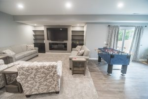 finished basement with carpeting and built in storage and carpeting