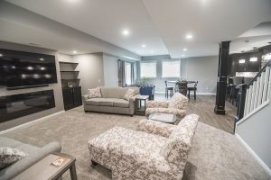 brighton Michigan finished basement with light grey walls and tons of natural light
