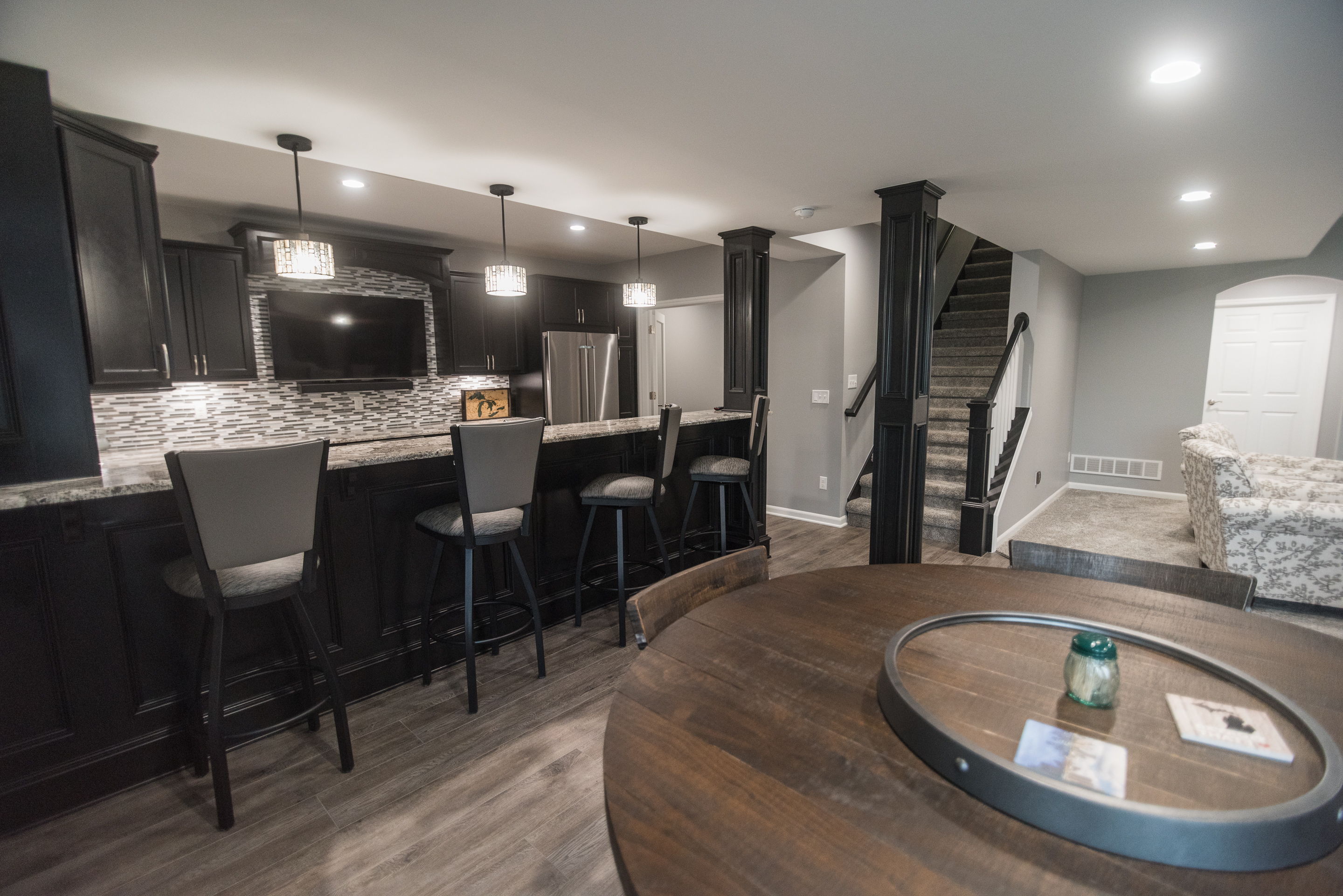 finished basement in brighton michigan with custom kitchen and entertainment space