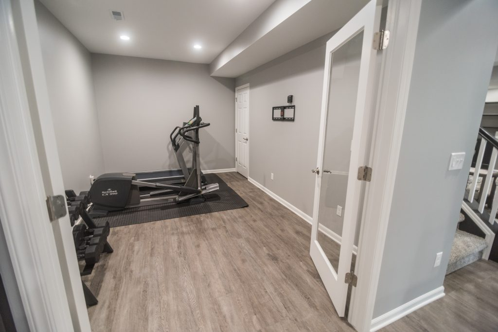 finished basement home gym area with vinyl plank flooring