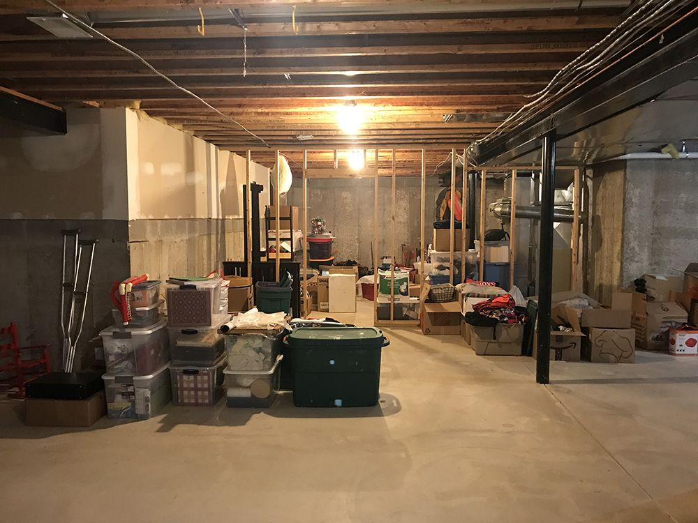 unfinished basement with storage sitting in the middle