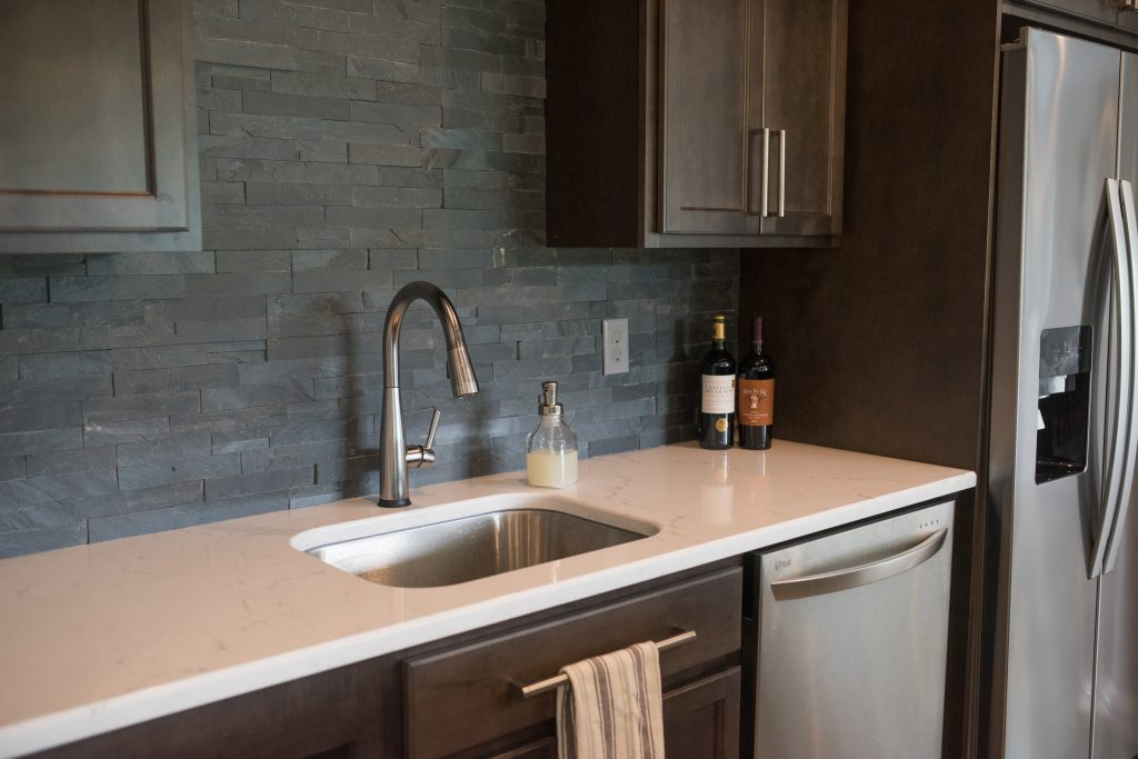 dark tile backsplash in custom bar