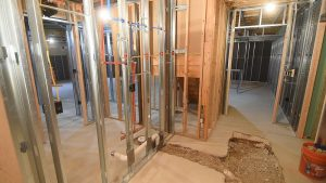 framed in basement with steel studs and plumbing with concrete breakup