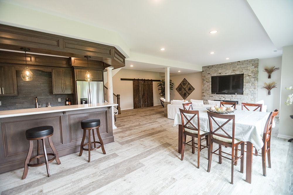 bar area in basement next to dining table and large living area