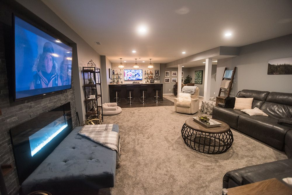 finished basement in south lyon, MI with carpet and fireplace and bar area