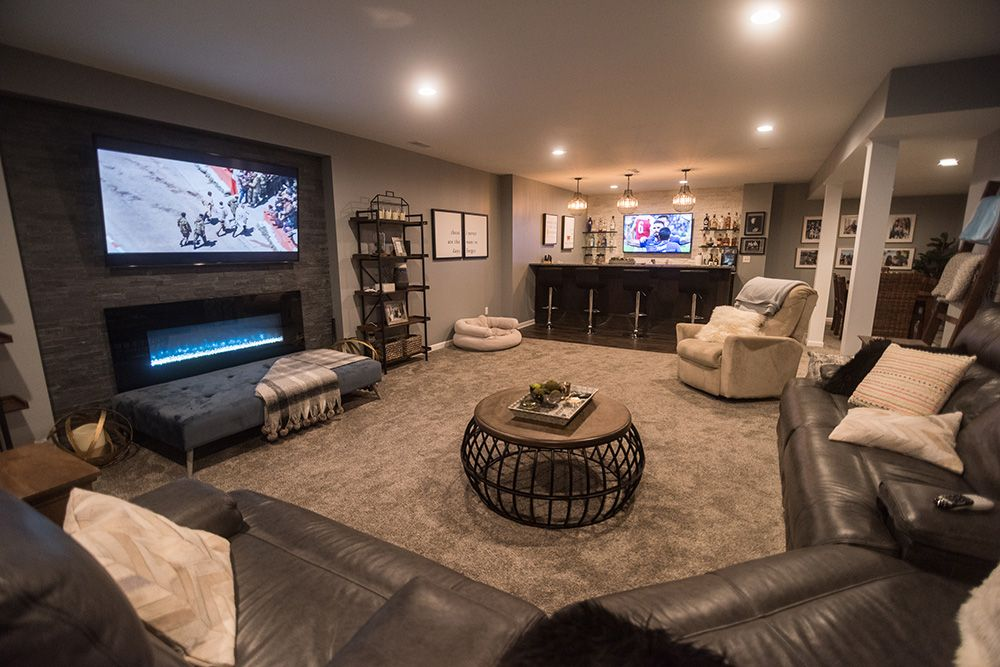 Finished Basement in South Lyon, MI with carpeting and a stone accent wall with fireplace