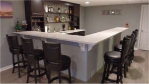 livonia michigan finished basement with large quartz bar and stools