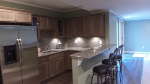milford michigan finished basement with a small kitchenette and walkout basement doors