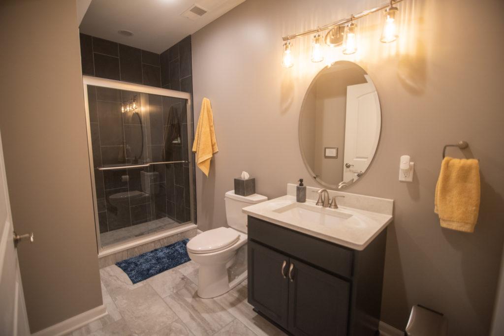 basement bathroom blue cabinetry