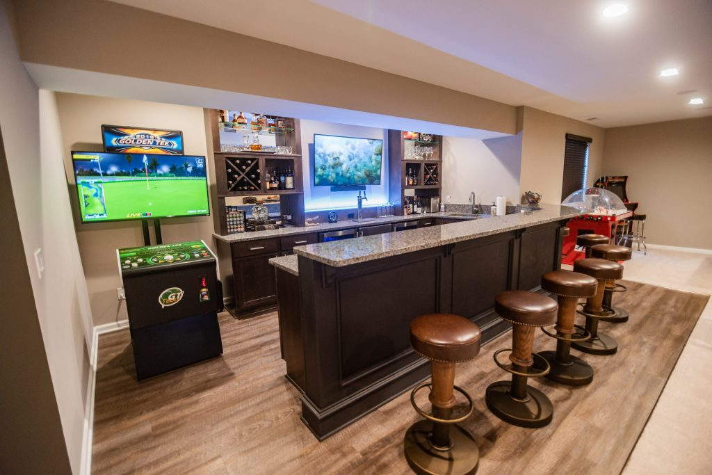 basement bar with entertainment space and seating for guests