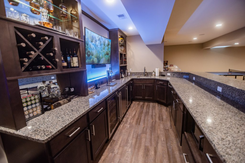 custom bar granite countertops wine storage dark cabinetry