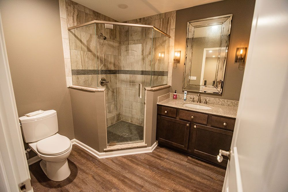finished bathroom in basement tile and vinyl plank flooring