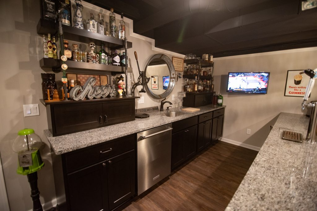 dark cabinetry and granite countertops