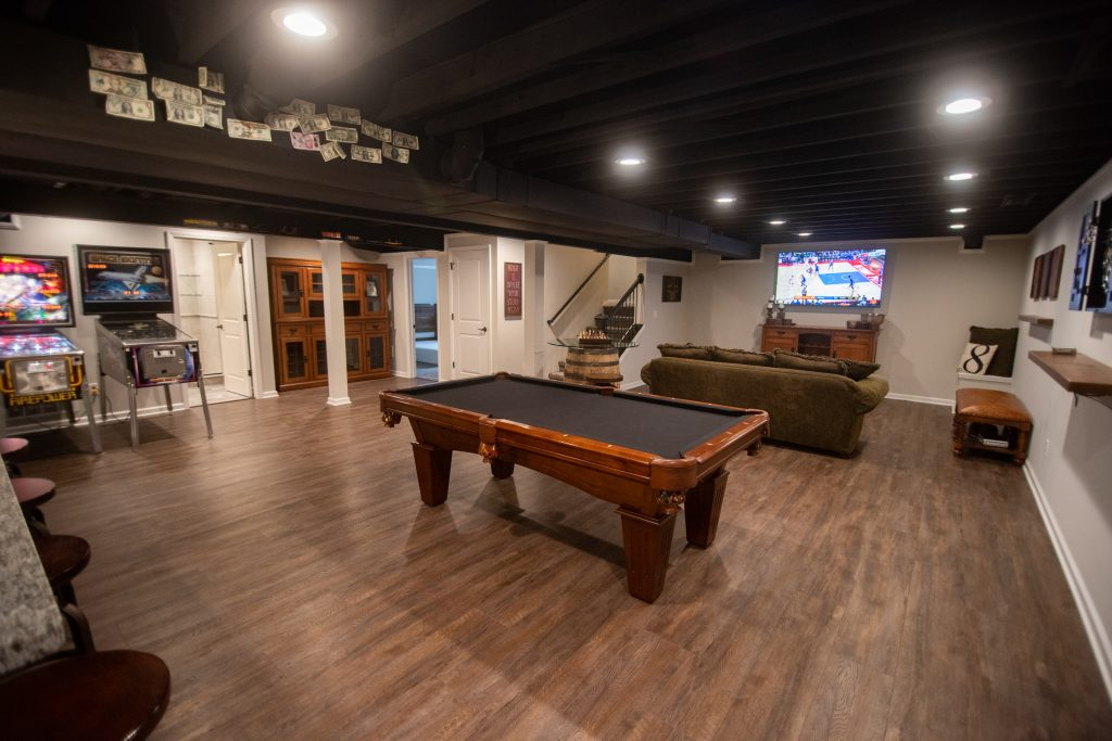 painted ceiling in basement with industrial design