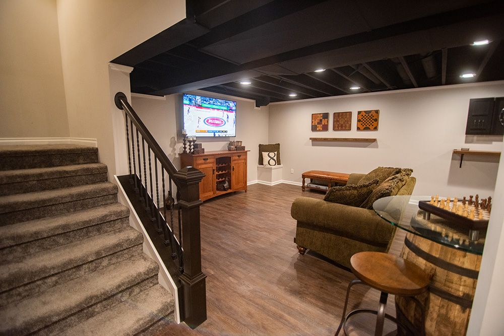 open rail staircase with dark stained handrail