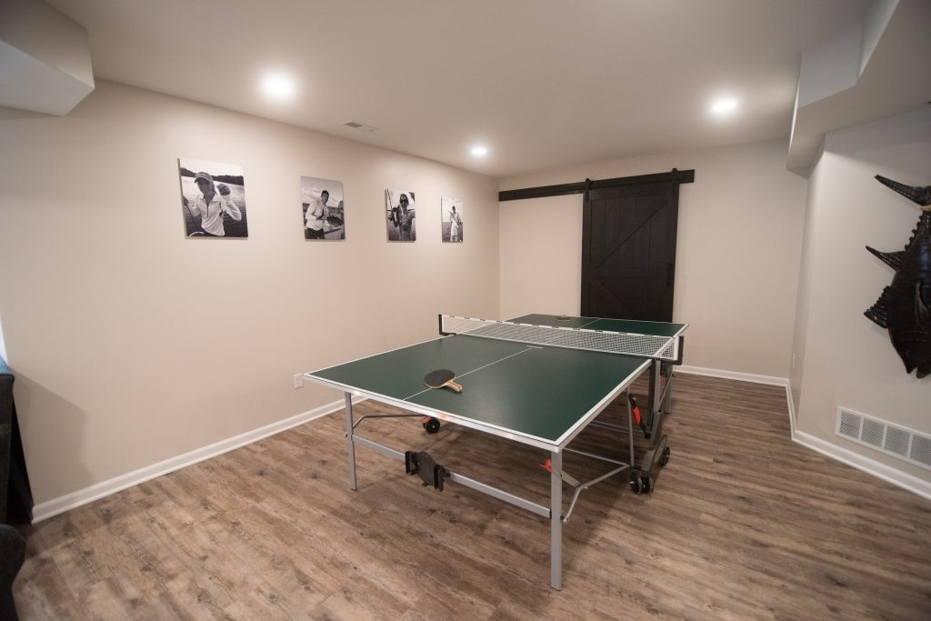 ping pong room with hickory vinyl plank flooring