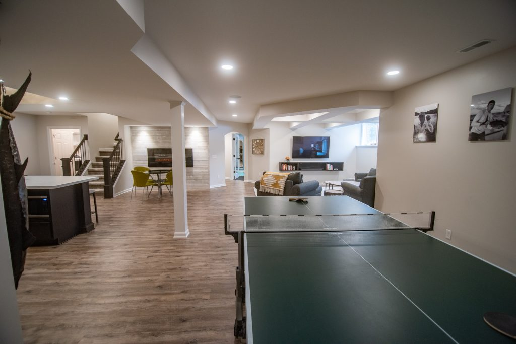 basement with ping pong table and vinyl plank flooring