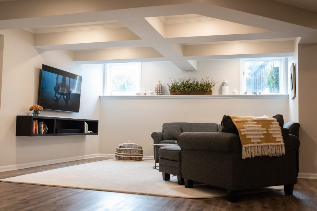 finished basement with rustic vinyl plank flooring and ceiling detail