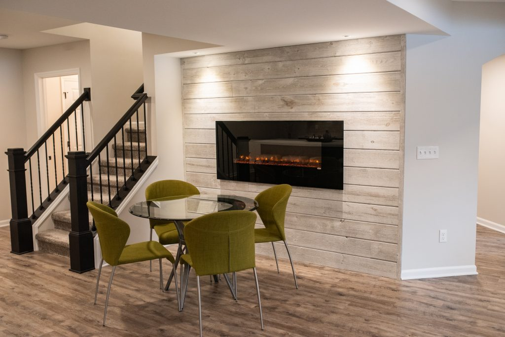 electric fireplace on ship lap wood wall
